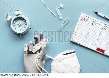 Week Planner, Schnelltest, Rapid Corona Test In German Language. Hand In Glove Holds Express Antigen