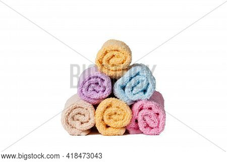 Set Of Clean Multi-colored Towels Isolated On White. Bathroom Towels Folded By A Slide.