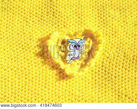 Detail Of A Yellow Fabric With A Yellow Owl Flex Sticker