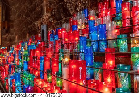 Montserrat, Barcelona - Spain. July 15, 2020: Colorful Candles In The Benedictine Abbey Of Montserra