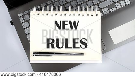New Rules - Top View Notebook Writing On Laptop