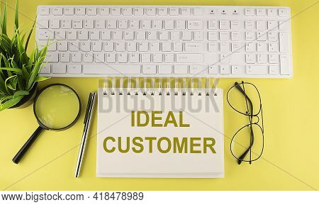 Office Desk Table Top View With Keyboard And Notebook Text Ideal Customer On Yellow Background