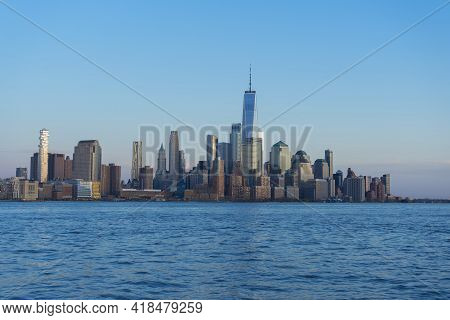New York City, Manhattan Skyline At Sunset Over Hudson River Viewed From New Jersey.