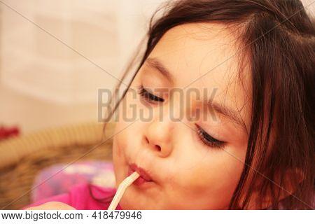 Little Girl Drinks Milk For Breakfast In Kindergarten. Healthy Baby Food.