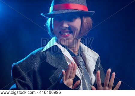 Portrait Of Ugle Middle-aged Woman With Hat. Model Posing In Funny Male Style In The Studio.