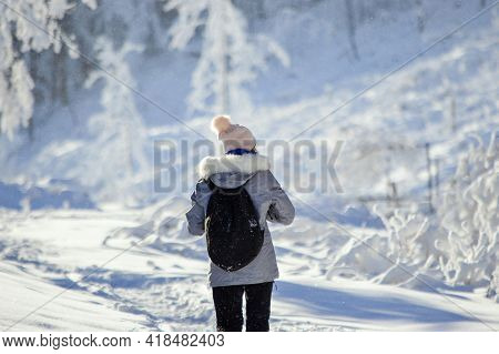 Woman On Winter Adventure Trip On Javorový, Mountains In Beskydy