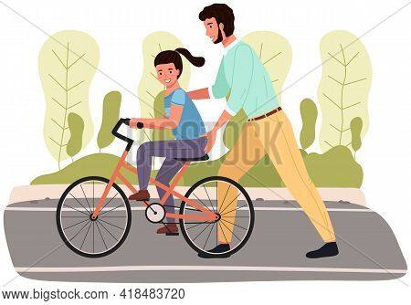 Dad Teaches Daughter To Ride Bike For First Time. Father Is Helping Girl Kid To Balance On Bicycle.