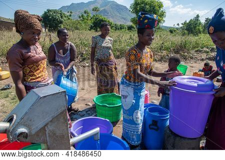 Mzuzu, Malawi. 30-05-2018. Mother And Children From The Community Are Gathered To Fetch Drinkable Wa
