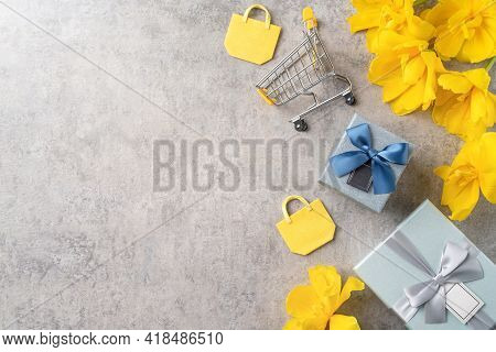 Concept Of Mother's Day Holiday Gift Shopping With Yellow Tulip Flower On Gray Background