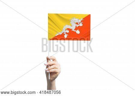 Beautiful Female Hand Holding Butane Flag, Isolated On White Background.