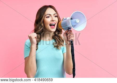 Pretty Young Woman Shouting In Megaphone On Pink Background