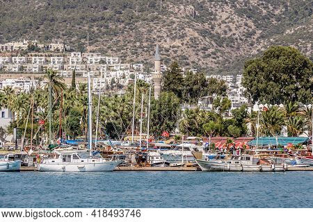 Bodrum, Turkey, July 2016: Bodrum Marina, Turkey, With Boats, Yachts And Tourists With The Mosque Mi