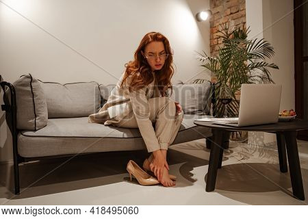 Stylish Young Businesswoman In A Business Suit Is Tired. She Had A Rough Day, She Took Off Her Uncom