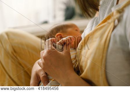 Newborn Baby Boy Sucking Milk From Mothers Breast. Portrait Of Mom And Breastfeeding Baby.