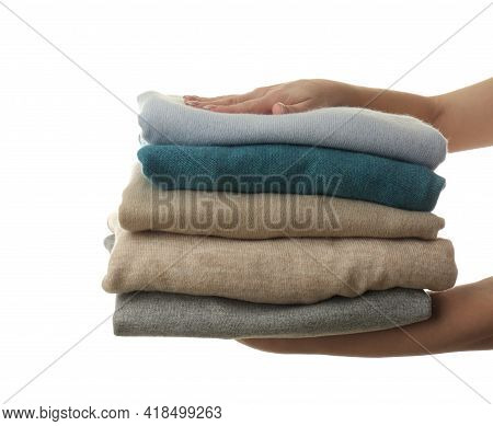 Woman With Folded Cashmere Clothes On White Background, Closeup