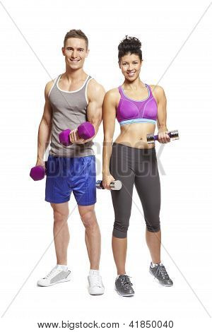 Young Man And Woman Exercising In Sports Outfits