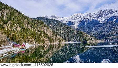Mountain Landscape. Lake Ritsa In The Spring Season. Located In Abkhazia, In The Caucasus Mountains.