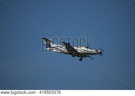 Pilatus Pc 12 Aircraft On The Final Approach To The International Airport In Zurich In Switzerland 2