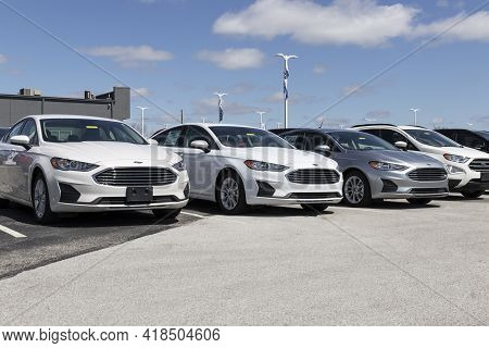 Plainfield - Circa April 2021: Ford Fusion Display At A Dealership. Ford Sells Traditional Gasoline,