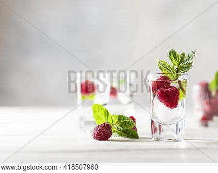 Raspberry Vodka Glass Shot With Fruit Inside. Fresh Summer Shots For Party. Berries In Alcohol Glass