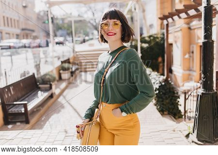 Laughing Romantic Girl In Green Sweater Enjoying Sunny Spring Day. Gorgeous Short-haired Woman In Su
