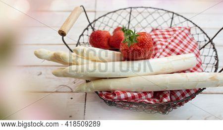 Fresh White Asparagus And Strawberries In A Basket On Bright Vintage Wood With Bokeh. Seasonal Food
