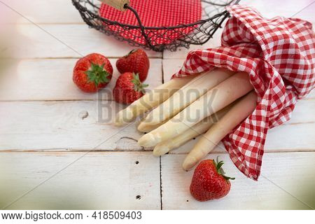 Fresh White Asparagus And Strawberries With Basket On Bright Vintage Wood. Seasonal Food Photography