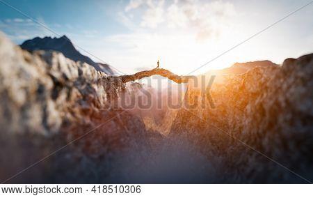 Man walking on the other side of mountain bridge. 3D illustration