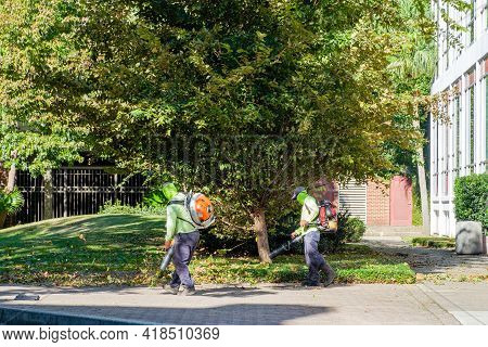 New Orleans, La  - October 29: Workers Using Leaf Blowers On Loyola University Campus During Storm C