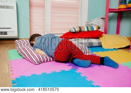 Little Boy Sleeping While Nap Time At The Kindergarten