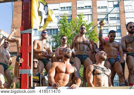 LGTBQ Pride Festival celebration. Barcelona - Spain. June 29, 2019: Young athletic men in swimwear and fetish attire are dancing on the platform at the Gay Parade