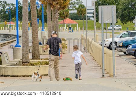 New Orleans, La - October 9: Two Boys And A Dog Walk Along Lake Pontchartrain On October 9, 2020 In