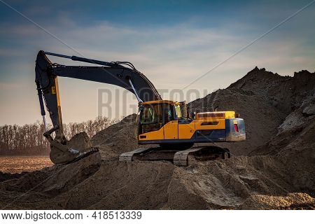 Large Construction Excavator Yellow On A Construction Site In A Quarry For Quarrying. Yellow Excavat
