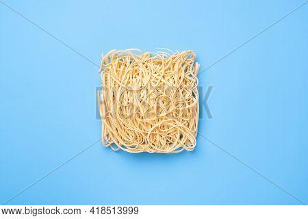 Instant Noodles On Blue Background, Top View. Ramen