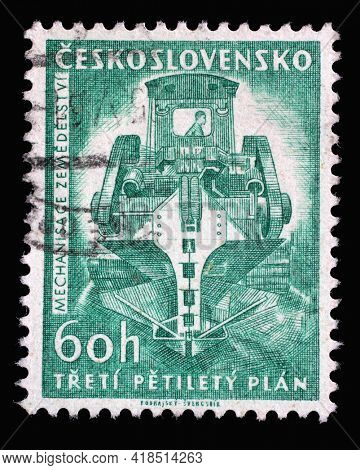 ZAGREB, CROATIA - SEPTEMBER 18, 2014: Stamp printed in Czechoslovakia shows Ditch-digging machine, Series 3rd Five-Year Plan, circa 1961