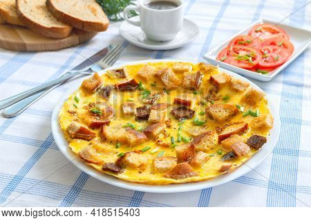 Omelet With Pieces Of Toasted Bread And A Cup Of Coffee. Delicious And Nutritious Breakfast.