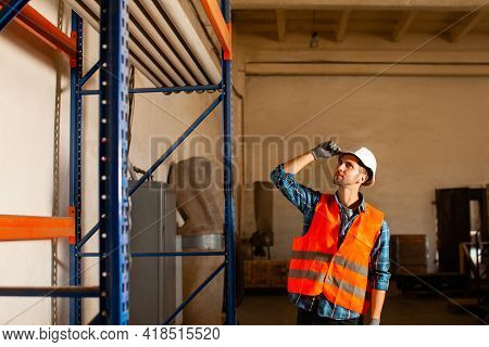 Portrait Of Young Man Member Of Factory Staff
