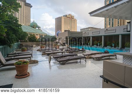 New Orleans, La  - October 26: Swimming Pool And Deck Furniture At Windsor Court Hotel With Downtown