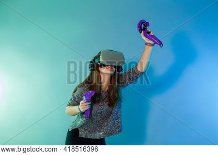 Woman Using A Gaming Gadget For Virtual Reality