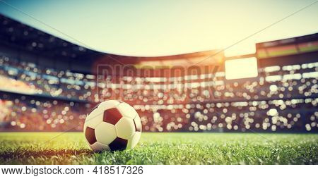 Football soccer ball on grass field on stadium. Sport 3d illustration