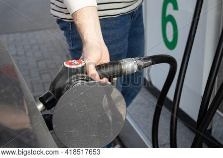 A Man Refueling The Car On Gas Station. Petrol Station. Gas Pump Close Up. An Automobile Is Getting