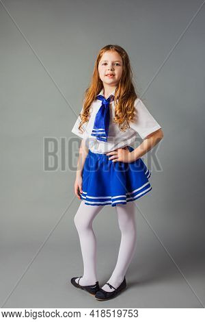 The Little Girl Is Posing In A Sailor Costume