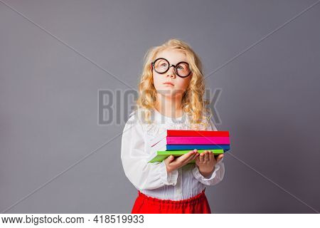 The Pretty Little Girl With Glasses Dressed In Teacher Uniform