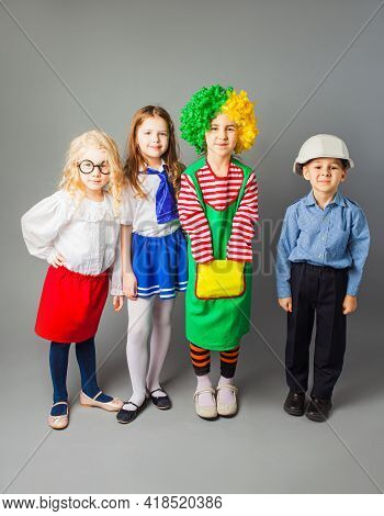 The Joyful Children In A Different Professions Costumes