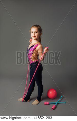 The Pretty Little Girl Trains In A Bright Sport Uniform