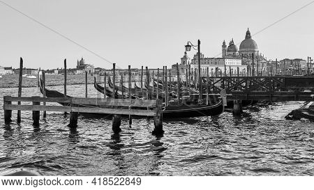 Venice in Italy. Black and white venetian scenic view with moored gondolas