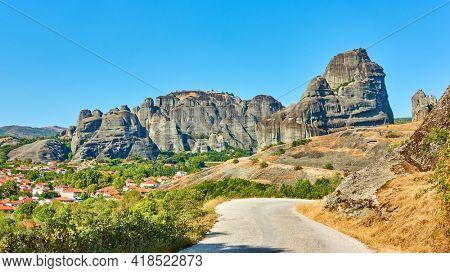Meteora in Greece. Greek landscape, scenic panoramic view wth rocks and road near Kastraki village in Thessaly