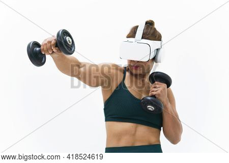Medium Close Up Shot Of Woman Wearing Vr Headset To Exercise With Dumbbell Young Female Athlete Weig