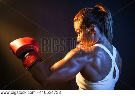 Close Up Shot Of Asian Female Boxer Is Punching Hands Boxing Glove On Dark Background With Copy Spac