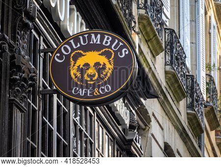 BAYONNE, FRANCE - CIRCA APRIL 2021: Columbus Cafe and Co sign. Olumbus Cafe is a a French coffe shop chain.